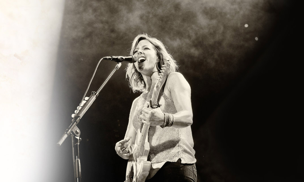 Sarah McLachlan Singing and playing guitar
